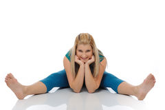 Beautiful happy woman stretching and doing fitness stock photo
