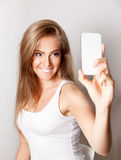 Beautiful happy woman taking a selfie Royalty Free Stock Photo