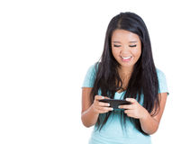 Beautiful happy woman texting on her mobile phone and seeing something she likes Royalty Free Stock Photos