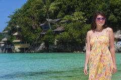 Beautiful happy woman on tropical beach and sea background Royalty Free Stock Image