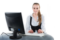Beautiful happy woman using computer at the office Stock Photos