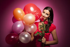 Beautiful happy woman with valentines day balloon on pink background Royalty Free Stock Photography