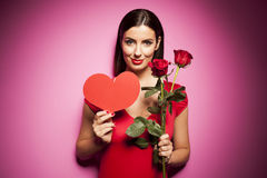 Beautiful happy woman with valentines day balloon on pink background Stock Image