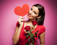 Beautiful happy woman with valentines day balloon on pink background Stock Photos
