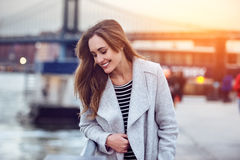 Beautiful happy woman walking near East River in New York City. And looking down royalty free stock photos