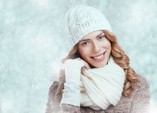 Beautiful happy woman in warm winter clothing Stock Photography