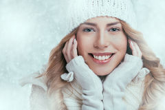 Beautiful happy woman in warm winter clothing Royalty Free Stock Image
