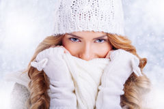 Beautiful happy woman in warm winter clothing Stock Photo