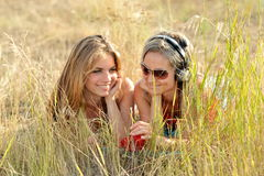 Beautiful happy women on field in summer Stock Photos