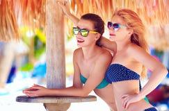 Beautiful happy women, friends enjoy summer vacation on tropical beach Royalty Free Stock Photos