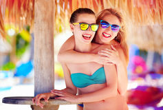 Beautiful happy women, friends enjoy summer vacation on tropical beach Stock Image