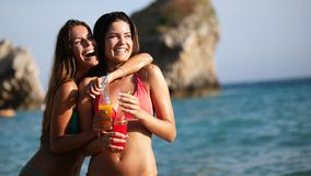 Beautiful happy women in sexy bikini enjoying summer vacation royalty free stock photography