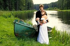 Beautiful happy young bride and groom Stock Photo