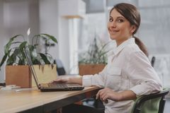 Charming young businesswoman working at her office royalty free stock photos