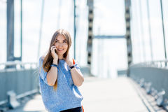 Beautiful happy young businesswoman using cell phone on city street. Beautiful young businesswoman using cell phone on city street stock photos