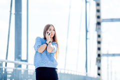 Beautiful happy young businesswoman using cell phone on city street. Beautiful young businesswoman using cell phone on city street stock photo