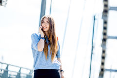 Beautiful happy young businesswoman using cell phone on city street. Beautiful young businesswoman using cell phone on city street stock photography