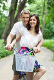 Beautiful happy young couple on bicycle Stock Photography