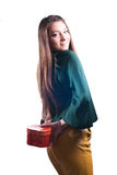 Beautiful happy young girl with gift box on white Royalty Free Stock Photography