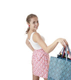 Beautiful happy young girl  holding shopping gift bags. Stock Photography