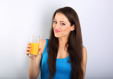 Beautiful happy young healthy casual woman holding the glass wit Royalty Free Stock Photo