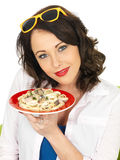 Beautiful Happy Young Hispanic Woman Holding a Plate of Spaghetti Carbonara Cream Pasta Stock Photos