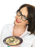 Beautiful Happy Young Hispanic Woman Holding a Plate of Vegetarian Linguine with Spinach and Mushrooms Stock Images