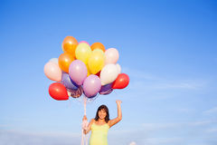 Beautiful happy young pregnant woman girl outdoors with balloons Royalty Free Stock Image