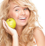 Beautiful and happy young woman with apple. Royalty Free Stock Photo