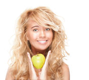 Beautiful and happy young woman with apple. Royalty Free Stock Image