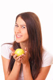 Beautiful and happy young woman with an apple Royalty Free Stock Photography