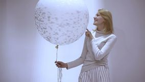 Beautiful Happy Young woman on birthday holiday party. Young woman playing with balloon.  stock footage