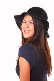 Beautiful and happy young woman in a black hat Royalty Free Stock Image