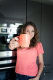 Beautiful happy young woman drinking coffee at home Royalty Free Stock Photography