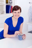 Beautiful young woman drinking tea at home Royalty Free Stock Photo