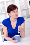 Beautiful young woman drinking tea at home Royalty Free Stock Photography