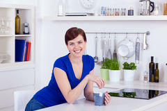 Beautiful young woman drinking tea at home Royalty Free Stock Photos
