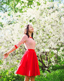 Beautiful happy young woman enjoying smell in flowering spring garden. Beautiful happy young woman enjoying smell in a flowering spring garden stock image