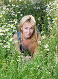 Beautiful happy young woman in the field of chamomiles Stock Photography