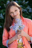 Beautiful happy young woman & flowers Royalty Free Stock Image