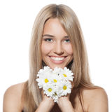 Beautiful happy young woman with flowers Royalty Free Stock Images
