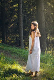 Beautiful  and happy young woman in the forest Royalty Free Stock Photos