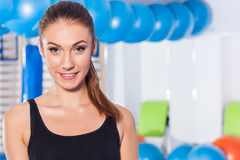 Beautiful happy young woman in gym. Gym shot. Crossfit hall. Stock Images