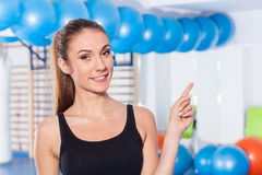 Beautiful happy young woman in gym. Gym shot. Crossfit hall. She Stock Images
