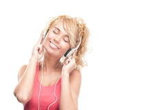 Beautiful and happy young woman with headphones. Royalty Free Stock Images