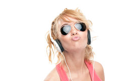 Beautiful and happy young woman with headphones. Stock Photo