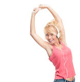 Beautiful and happy young woman with headphones. Stock Photography