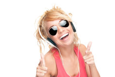 Beautiful and happy young woman with headphones. Royalty Free Stock Photo