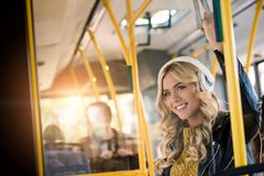 beautiful happy young woman in headphones listening music stock photo
