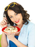 Beautiful Happy Young Woman Holding a Plate of Carbonara Cream Pasta Stock Images
